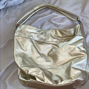 Gold Roxy purse
